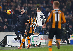 Manchester United manager Jose Mourinho (right) attempts to control the ball as it goes over the touchline during the EFL Cup Semi Final, Second Leg match at the KCOM Stadium, Hull.