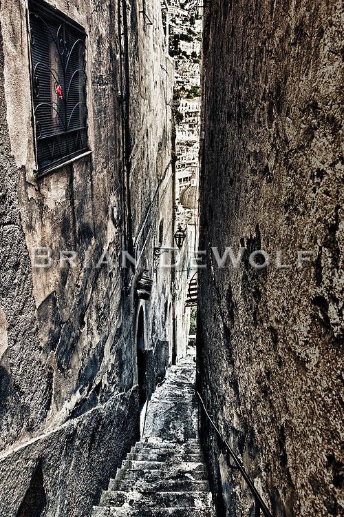 Positano, Italy is built upon the side of a mountain that descends into the Mediterranean Sea. Taking these narrow alleyways is the most direct way to get from the top of the city to the bottom.