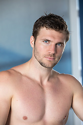 portrait of a hot shirtless man with blue eyes and brown hair