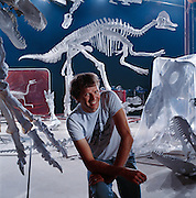 A collection of Canadian and Chinese dinosaurs discovered over five years of expeditions, is prepared for a traveling show under the direction of Paleontologist Phil Currie.