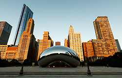 The Anish Kapoor designed sculpture Cloud Gate at sunrise. Nicknamed The Bean in Millennium Park, Chicago