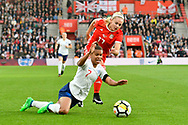 Nikita Parris (7) of England is fouled by Charlotte Estcourt (17) of Wales during the FIFA Women's World Cup UEFA Qualifier match between England Ladies and Wales Women at the St Mary's Stadium, Southampton, England on 6 April 2018. Picture by Graham Hunt.