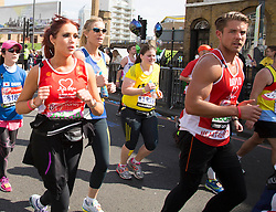 Virgin London Marathon 2013..Celebrity runners. Amy Childs at 21 miles with boyfriend David Peters near her in red to, April 21, 2013. Photo by: Gavin Rodgers / i-Images