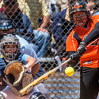 051113       Cable Hoover<br /> <br /> Gallup Bengal Crystal Pablo (21) knocks a pitch away from Goddard Rockets catcher Kaitlyn Renteria (11) during the first round of the state tournament at Gallup High School Saturday.