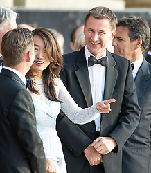 """© Licensed to London News Pictures . Oxfordshire , UK . FILE PICTURE DATED 12/07/2018 of LUCIA GUO and her husband , British Foriegn Secretary JEREMY HUNT , at Blenheim Palace , during a visit by US President Donald Trump . Hunt has mistakenly referred to his Chinese wife as """"Japanese"""" during an official visit to China . Photo credit: Joel Goodman/LNP"""
