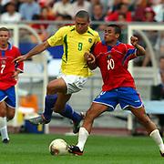 Costa Rica's Walter Centano tackles Brazil's Ronaldo