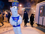 """Studenten als Wahlhelfer der Partei """"Einiges Russland"""" verkleidet als Eisbaeren machen bei Temperaturen von -27 Grad Celsius Werbung fuer die Partei in den Strassen und Geschaeften der sibirischen Stadt Jakutsk.<br /> <br /> Students dressed as a polar bears for Vladimir Putins party United Russia trying to convince people on the street to vote them a few days before the Duma elections in Russia on the streets of Yakustk. Yakutsk is a city in the Russian Far East, located about 4 degrees (450 km) below the Arctic Circle. It is the capital of the Sakha (Yakutia) Republic (formerly the Yakut Autonomous Soviet Socialist Republic), Russia and a major port on the Lena River. Yakutsk is one of the coldest cities on earth, with winter temperatures averaging -40.9 degrees Celsius."""