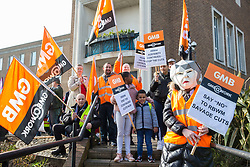 Maidenhead, UK. 23rd February, 2019. A woman wearing a Theresa May mask joins members of the Windsor and Maidenhead branches of the Labour Party and UNISON and GMB trade unions protesting outside Maidenhead Town Hall in Prime Minister Theresa May's constituency against planned spending cuts of £6.8m to the 2019/2020 budget by the Royal Borough of Windsor and Maidenhead. Over 1,000 people had signed a petition to the council demanding an alternative to the cuts.