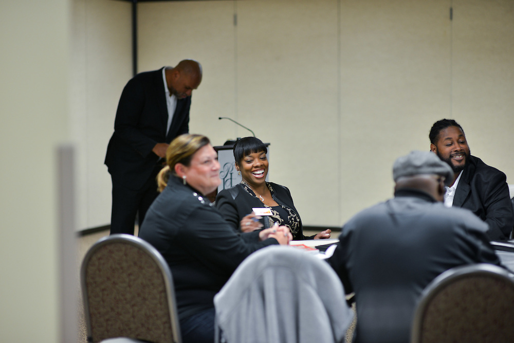 Residents at a meeting of the Partnership for the Minority Business Accelerator (PMBA) at President's Hall at the Akron Urban League.