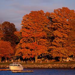 A boat and fall foliage. Seacoast.  New Castle, NH