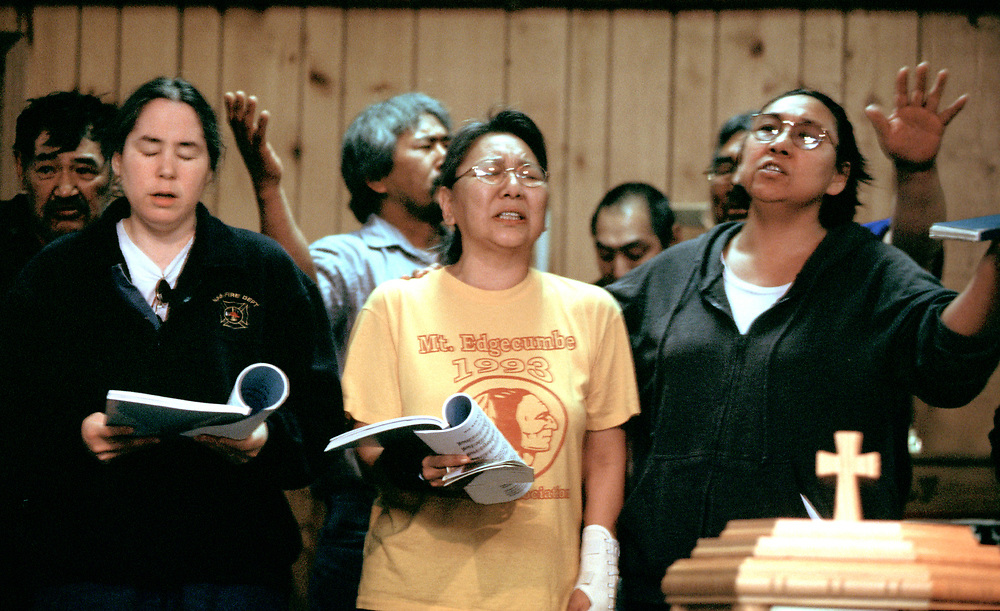 A group of people sing during the Iñupiaq service at the Presbiterian Church. The church is over a hundred years-old.<br /> <br /> May 18, 20:30