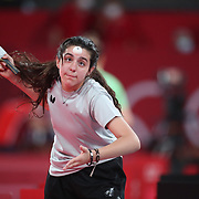 TOKYO, JAPAN - JULY 24: Twelve year old Hend Zaza of Syria, the youngest competitor in the Olympic Games in Tokyo, in action against  Jia Liu of Austria in the Women's Singles  Preliminary Round in the Tokyo Metropolitan Gymnasium at the Tokyo 2020 Summer Olympic Games  on July 24, 2021 in Tokyo, Japan. (Photo by Tim Clayton/Corbis via Getty Images)