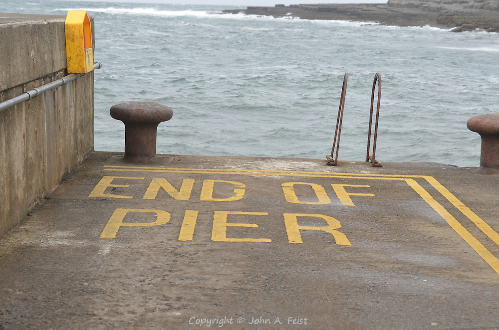 We found the idea that there needs to be a warning at the end of the pier amusing.  We suspect it is helpful in dark and foggy conditions.  Doolin, County Clare, Ireland.