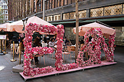 Floral display outside the EL&N restaurant in the upmarket area of Knightsbridge on 14th April 2021 in London, United Kingdom. Knightsbridge is one of the principal areas for exclusive, luxury goods in West London. It is known as a district where the rich and wealthy shop, mostly for high end fashion and jewellery.