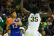 WACO, TX - JANUARY 7: Kelly Oubre Jr. #12 of the Kansas Jayhawks brings the ball up court against the Baylor Bears on January 7, 2015 at the Ferrell Center in Waco, Texas.  (Photo by Cooper Neill/Getty Images) *** Local Caption *** Kelly Oubre Jr.