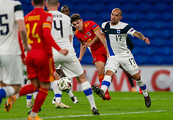 CARDIFF, WALES - Wednesday, November 18, 2020: Wales' Dylan Levitt (L) shoots under pressure from Finland's Nikolai Alho during the UEFA Nations League Group Stage League B Group 4 match between Wales and Finland at the Cardiff City Stadium. Wales won 3-1 and finished top of Group 4, winning promotion to League A. (Pic by David Rawcliffe/Propaganda)