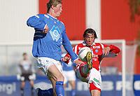 Tor Hogne Aarøy, Aalesund. Kjetil Byfuglien, Kongsvinger. <br /> <br /> Fotball: Kongsvinger - Aalesund 2-2 (5-2 e. straffer). NM 2004 herrer, 3. runde. 8. juni 2004. (Foto: Peter Tubaas/Digitalsport.