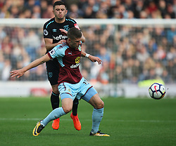 Aaron Cresswell of West Ham United (L) and Johann Gudmundsson of Burnley in action - Mandatory by-line: Jack Phillips/JMP - 14/10/2017 - FOOTBALL - Turf Moor - Burnley, England - Burnley v West Ham United - English Premier League