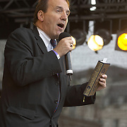 Simon Hughes MP holding a copy of the Quran at the opening of the first Eid in the Square, celebrations for Eid-ul Fitr in Trafalgar Square, London, 28 October 2006<br />