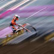 A blur of motion as Scott Wennerstrom, KTM,  competes during the Monster Energy AMA Supercross series held at MetLife Stadium. 62,217 fans attended the event held for the first time at MetLife Stadium, New Jersey, USA. 26th April 2014. Photo Tim Clayton