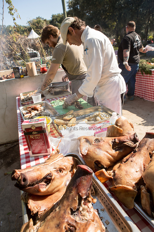 Irish Chef J P McMahon, left, prepares BBQ pig during Cook it Raw outdoor BBQ event on Bowen's Island October 26, 2013 in Charleston, SC.