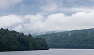 Grahamsville, New York - Clouds cover the tops of mountains around the Rondout Reservoir on June 18, 2013.