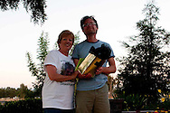During the Mother of an Angel Friendship Network Support Group meeting, Martha Tessmer, the group's founder, gives photographer Bryan Farley a gift from the group. Duane Tessmer, her husband took these last photos.