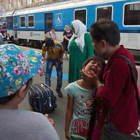 Illegal migrant child cries as family waits for their train to travel to Germany at the main railway station Keleti in Budapest, Hungary on August 31, 2015. ATTILA VOLGYI