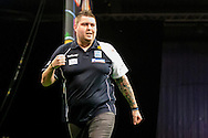 Michael Smith celebrates winning a leg during the PDC Betway Premier League at Westpoint Arena, Exeter, United Kingdom on 3 March 2016. Photo by Shane Healey.