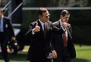 President H W Bush gives a thumbs up sign as he returns to the White House. ..Photograph by Dennis Brack, BB 29
