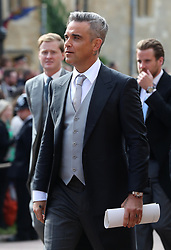 Robbie Williams after the wedding of Princess Eugenie to Jack Brooksbank at St George's Chapel in Windsor Castle
