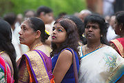 Hindu devotees participate in the annual Tamil chariot festival at the Murugan Temple in Highgate, London, England 17th July 2016. Thousands attend the colourful celebration as the temple's Goddess Amman (Tamil for Mother) is paraded on a beautifully decorated chariot pulled by the people through the streets around the temple, which brings to a close the four week Mahotsava festival.