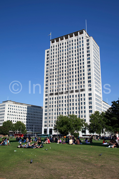 The Shell Centre at Jubilee Gardens, Waterloo, London. These federal lookng buildings loom over the park, a place where tourists gather in the Summer sun.