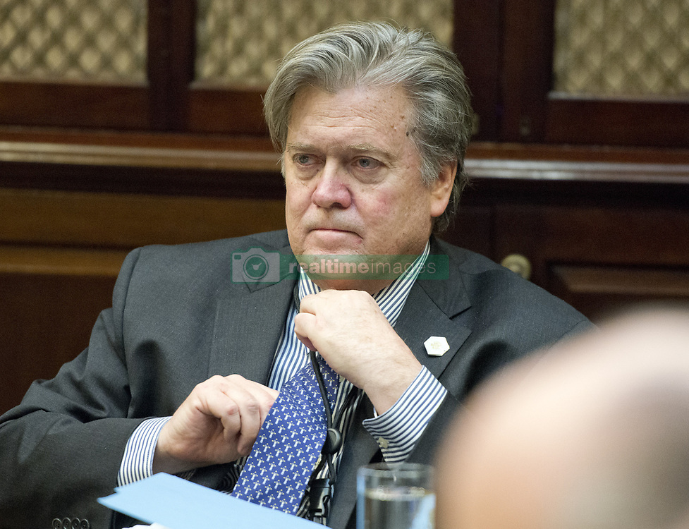January 31, 2017 - Washington, District of Columbia, U.S. - Assistant to the President and Chief Strategist STEVE BANNON adjusts his tie as United States President Donald Trump holds a listening session with cyber security experts in the in the Roosevelt Room of the White House. (Credit Image: © Ron Sachs/Pool/CNP via ZUMA Wire)