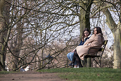 © Licensed to London News Pictures. 07/03/2021. London, UK. Members of the public enjoy sunny afternoon in London's Battersea Park. From tomorrow two members from different households are allowed to meet up outside. Photo credit: Marcin Nowak/LNP