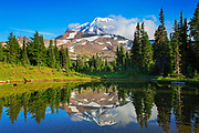 The north face of Mount Rainier from a tarn at Spray Park