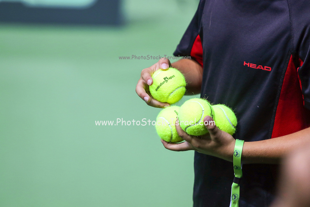 ballboy waiting on the side of a tennis court