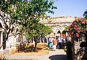 Tourist group exploring cloisters of  hermitage church of San Giovanni, San Giovanni degli Eremiti, Palermo, Sicily, Italy in 1999