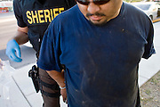 03 APRIL 2008 -- GUADALUPE, AZ:  Undercover deputies with the Maricopa County Sheriff's Department arrest a man wanted on misdemeanor warrants and drug possession during an anti-crime sweep in Guadalupe, AZ, Thursday. The Maricopa County Sheriff's Department has started high profile zero tolerance crime sweeps targeting illegal immigrants but also arresting anyone they find breaking the law or with outstanding warrants. All of the previous sweeps have been in Phoenix city limits. This was the first one outside Phoenix, Guadalupe is a working class unincorporated town south of Phoenix. Most of the town's residents are Native Americans and Hispanics and hundreds of people lined the street to protest the sweep.    Photo by Jack Kurtz / ZUMA Press