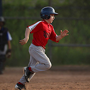 Action during the Norwalk Little League baseball competition at Broad River Fields,  Norwalk, Connecticut. USA. Photo Tim Clayton