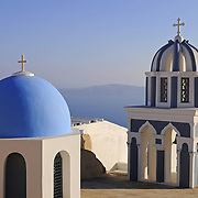 Domes of Orthodox church in Firostefani Fira Santorini with the sea and caldera on background