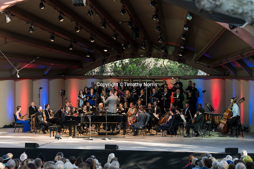Conductor Kevin Fox leads The Ojai Festival Singers, Steve Beck (organ), Joseph Gramley (bells) and Molly Yeh (bells) in Charles Ives' Psalm 90 at the 68th Ojai Music Festival at Libbey Bowl on June 15, 2014 in Ojai, California.
