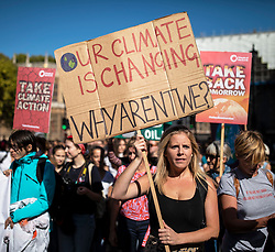 © Licensed to London News Pictures. 20/09/2019. London, UK. Students and supporters join the Global Climate Strike in Westminster. Protests about the climate crisis are being led by young people in cities around the world, with millions expected to attend. Photo credit: Rob Pinney/LNP
