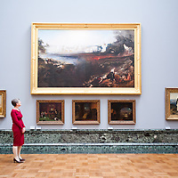 London, UK - 13 May 2013: Penelope Curtis, director at Tate Britain poses for a picture next to 19th century paintings. The new chronological presentation of the world's greatest collection of British art will allow visitors to experience the national collection of British art in a continuous chronological display from the 1500s to the present day.