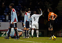Photo: Jed Wee.<br /> Bolton Wanderers v Sevilla. UEFA Cup. 14/12/2005.<br /> <br /> Bolton substitute Bruno N'Gotty celebrates after his goal as Sevilla are shocked.