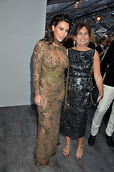 Left to right, KIM KARDASHIAN WEST and ALEXANDRA SHULMAN at British Vogue's Centenary Gala Dinner in Kensington Gardens, London on 23rd May 2016.