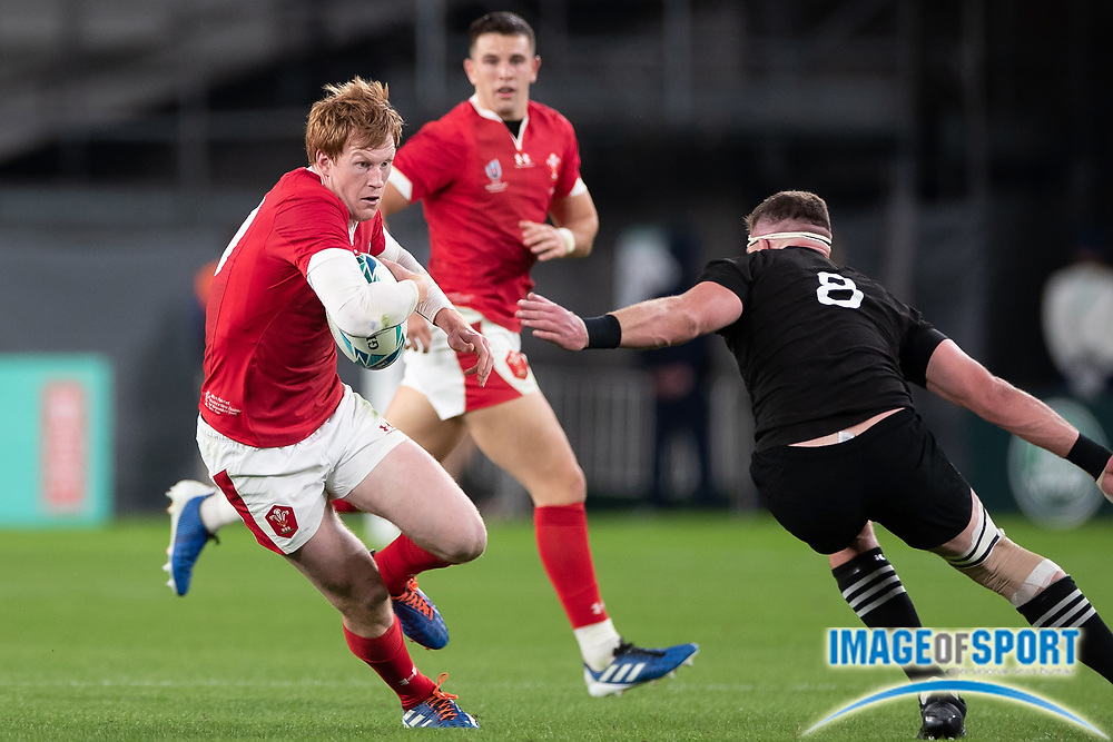 Rhys Patchell of Wales runs with the ball during the Rugby World Cup bronze final match between New Zealand and Wales Friday, Nov, 1, 2019, in Tokyo. New Zealand defeated Wales 40-17.  (Flor Tan Jun/Espa-Images-Image of Sport)