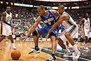 Jazz guard Earl Watson, right, tries to steal the ball from Magic guard Arron Afflalo (4) during the second half of the NBA basketball game between the Utah Jazz and the Orlando Magic at Energy Solutions Arena, Wednesday, Dec. 5, 2012.