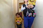 """Veronica is 24 years of age, she is a mother of four children and the fifth, a boy is in her womb (seen in this picture). From 11 months the youngest (she is holding the child) to 7 years the oldest (not in picture). She is from Askeran, a province nearby Stepanakert in Nagorno Karabakh. She is unemployed and her husband who is from Jabrayil served in the army as volunteer and managed to survive the war as he returned home on the 10th of November after the peace deal was reached between the leaders of Armenia and Azerbaijan. On Tuesday, Dec 28, 2020 - she said that they will not return to Nagorno Karabakh. Her family is now looking for opportunities to work and live in Armenia. They're now under Armenian government logistics support for food, shelter and other essential supplies. She is living at an abandoned building of former """"SOVIET Hotel"""" in Metsamor, which is located near the Armenian Nuclear Power Plant, that is the only nuclear power plant in the South Caucasus, located 36 kilometres west of Yerevan in Armenia. (Photo/ Vudi Xhymshiti)"""