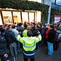 London December 26 Security personnel try to control the bargain hunters crowd  outside  Selfridges on Oxford Street. More than 50,000 people will pass through the doors at Selfridges and the store expect to take in excess of £1M per hour at peak time on the first day of this year Sales...***Agreed Fee's Apply To All Image Use***.Marco Secchi /Xianpix. tel +44 (0) 771 7298571. e-mail ms@msecchi.com .www.marcosecchi.com